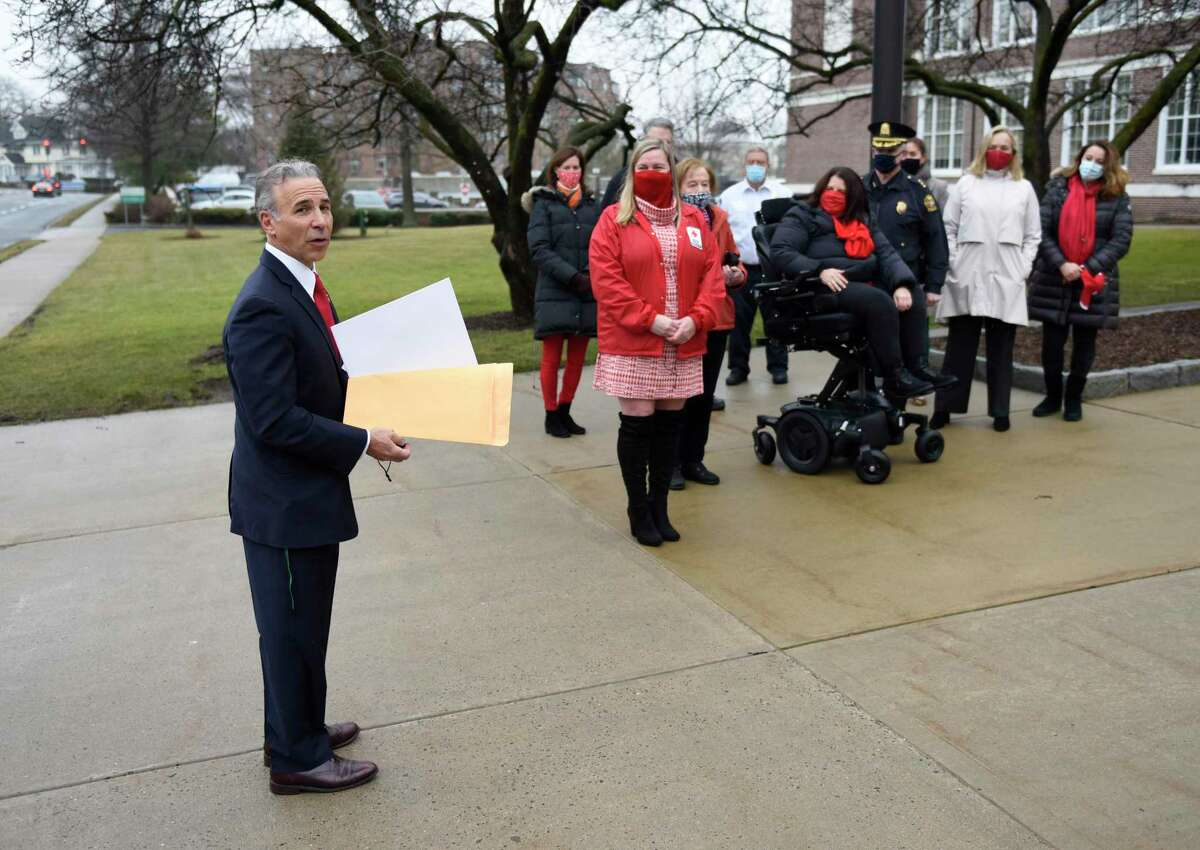First Selectman Fred Camillo makes a proclamation declaring March as Red Cross Month outside Town Hall in Greenwich, Conn. Monday, March 1, 2021. Representatives of the American Red Cross Metro New York North Chapter joined Camillo in raising a Red Cross flag outside of Town Hall.