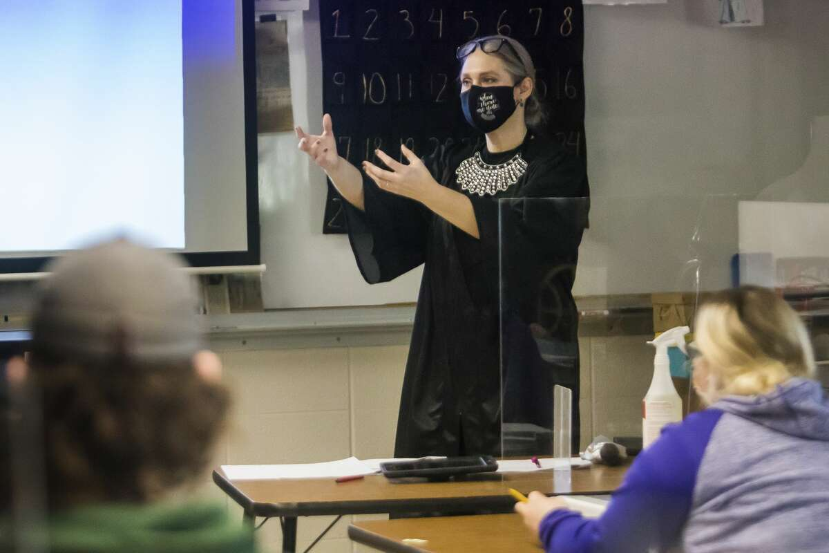 Erin Martin, a physics teacher at Bullock Creek High School, teaches class dressed as Ruth Bader Ginsburg Monday, March 1, 2021 as staff and students celebrate Women's History Month with a scavenger hunt. Notable figures represented include Marie Curie, Frida Kahlo, Eleanor Roosevelt and fifteen others. (Katy Kildee/kkildee@mdn.net)