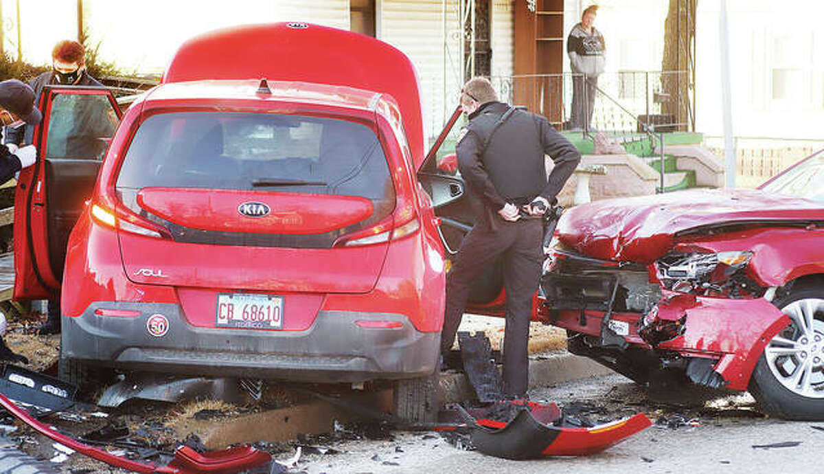 Debris littered Brown Street Monday following a head-on crash that closed the road to all traffic for about 45 minutes.