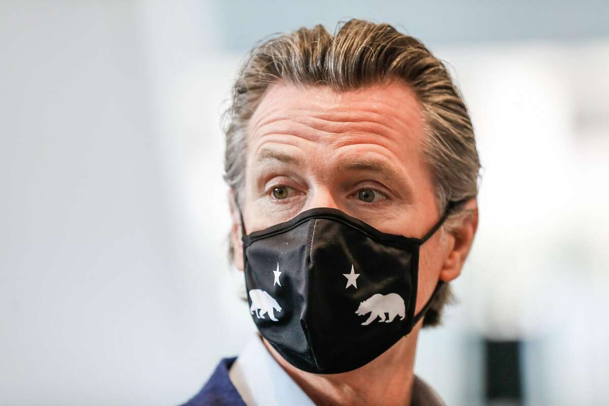 This file photo shows Governor Gavin Newsom during a tour of the Moscone Center vaccination site on Friday, Feb. 12, 2021 in San Francisco, Calif.