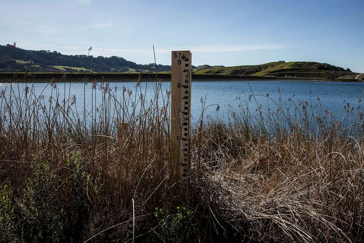 A depth gauge is partially exposed at Briones Reservoir in Orinda on Sunday. A mostly dry February has added to the likelihood of extended drought.