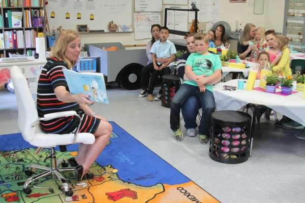 "In this file photo, Bear Lake Schools principal Sarah Harless reads the book ""I Will Love You Forever"" to first grade students and their mothers at the annual Mother's Day Tea in Ann Edmondson's class in 2018."