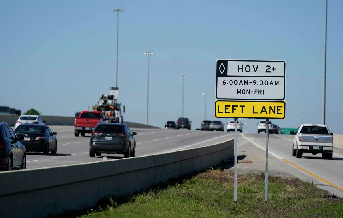 A new sign noting off-peak HOV use along U.S. 290 is shown near 34th Street on Feb. 7, 2021 in Houston. The off-peak HOV lanes will operate from 34th Street to west of Barker-Cypress Road.