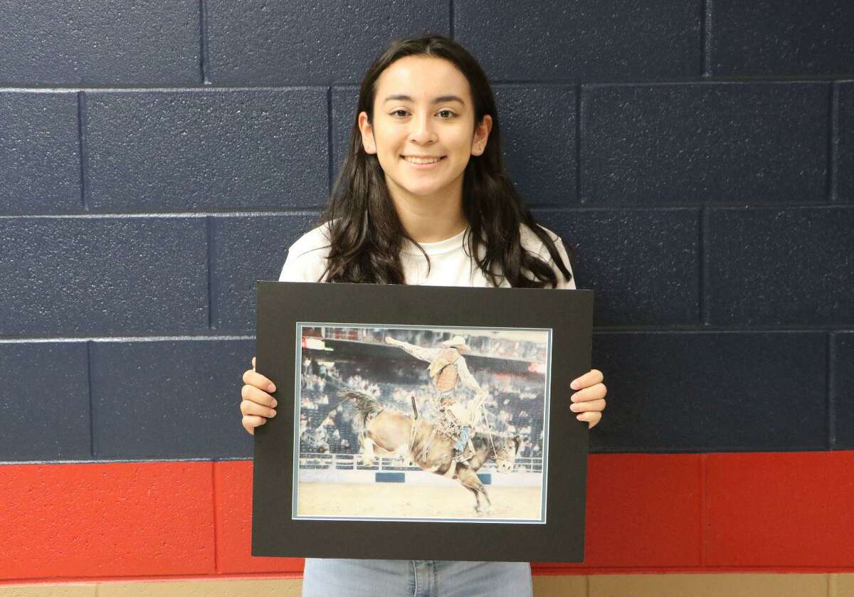 """Dawson High School senior Marissa Devivar is among Pearland ISD students hoping their art is chosen for a virtual auction by the Houston Livestock Show and Rodeo. Her piece, """"8 Seconds of Fame,"""" was made with color pencils."""