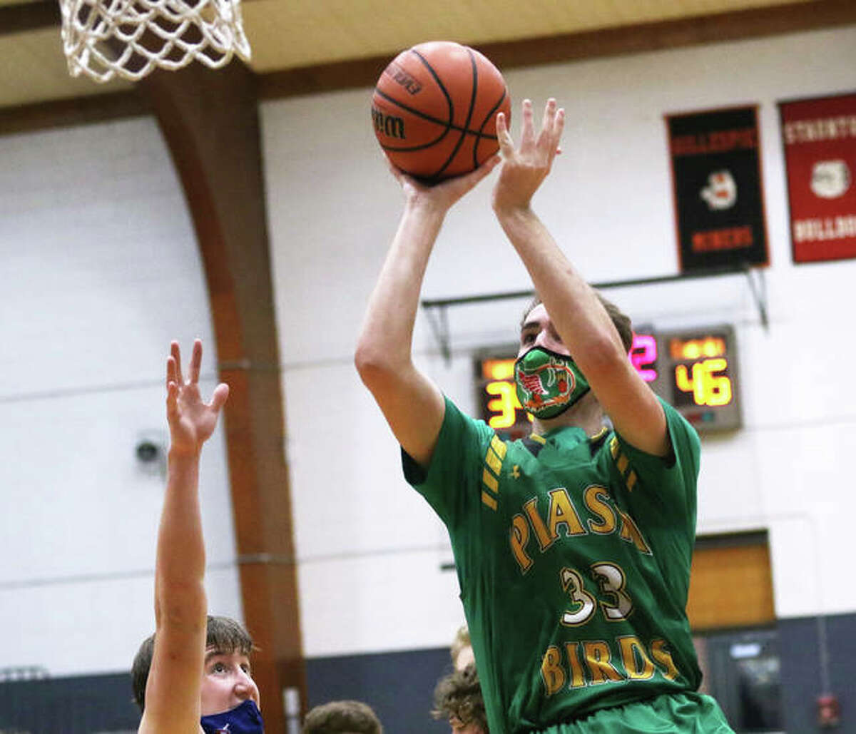 Southwestern's Addis Moore goes up to score in the second half of the Piasa Birds' victory last Wednesday at Carlinville. In the first quarter against the Cavaliers, Moore became the seventh member of Birds boys basketball's 1,000-points club.