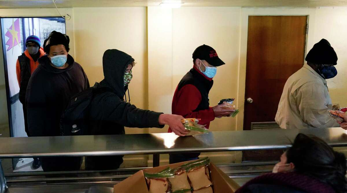 People seeking shelter from subfreezing temperatures receive a meal at Travis Park Methodist Church during the weeklong winter blast. Readers are calling on the Texas Lege to prevent future power crises.