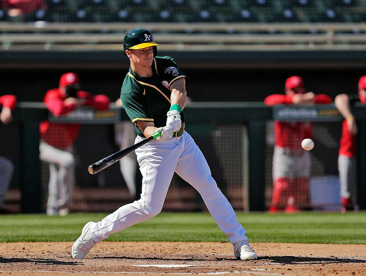 Matt Chapman plays Monday in his first game back since recovering from hip surgery as the Oakland Athletics played the Cincinnati Reds at Hohokam Stadium in Mesa, Ariz..