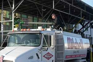 Mike Mitchell, Distribution Manager for Mitchell Oil, fills a delivery truck, at the Mitchell Oil depot, with home heating oil on Wednesday afternoon. Mitchell has been making deliveries this week to help keep up with the demand. January 3, 2018, in Danbury, Conn.