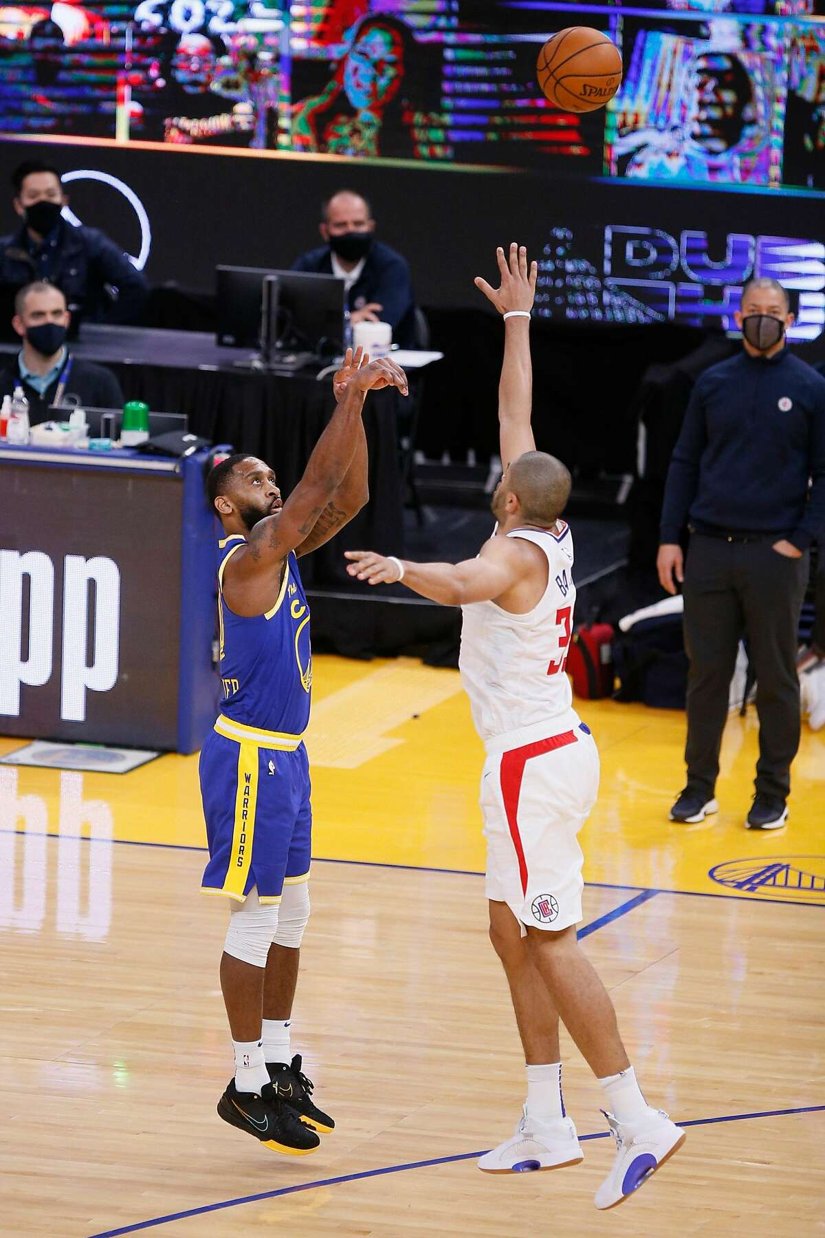 Golden State Warriors guard Brad Wanamaker (10) scores a three-point field goal against LA Clippers forward Nicolas Batum (33) in the fourth quarter during an NBA game at Chase Center, Friday, Jan. 8, 2021, in San Francisco, Calif. The Warriors won 115-105.