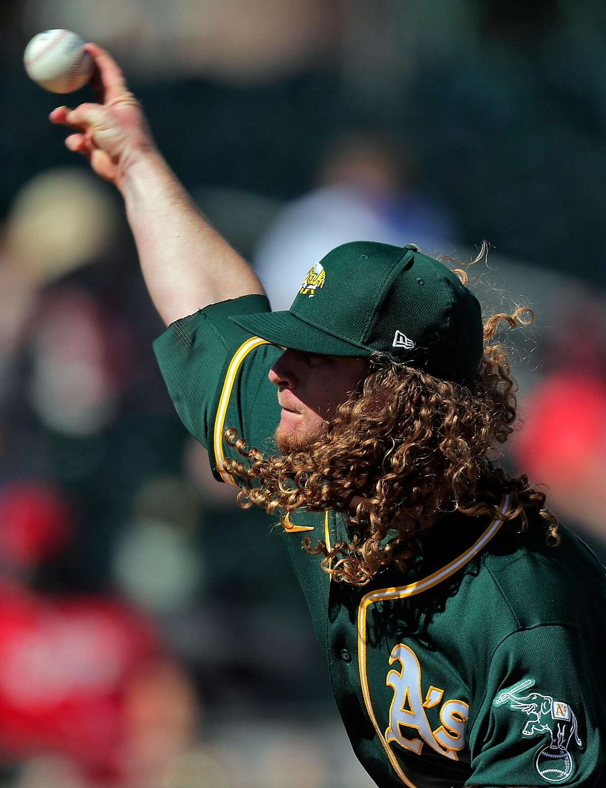 Grant Holmes (67) started for the Oakland Athletics as they took on the Cincinnati Reds at Hohokam Stadium.