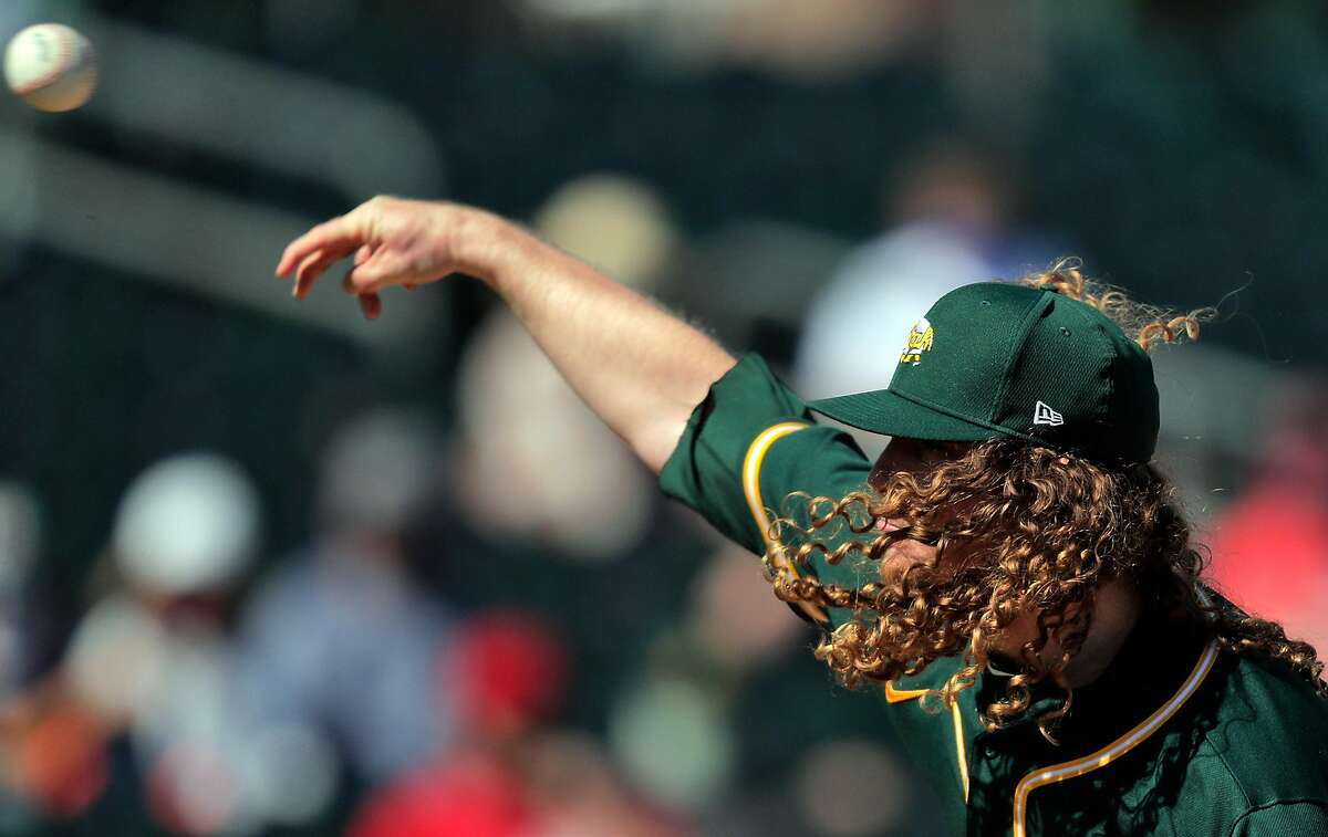 Grant Holmes (67) started for the Oakland Athletics as they took on the Cincinnati Reds at Hohokam Stadium in Mesa, Ariz., on Monday.
