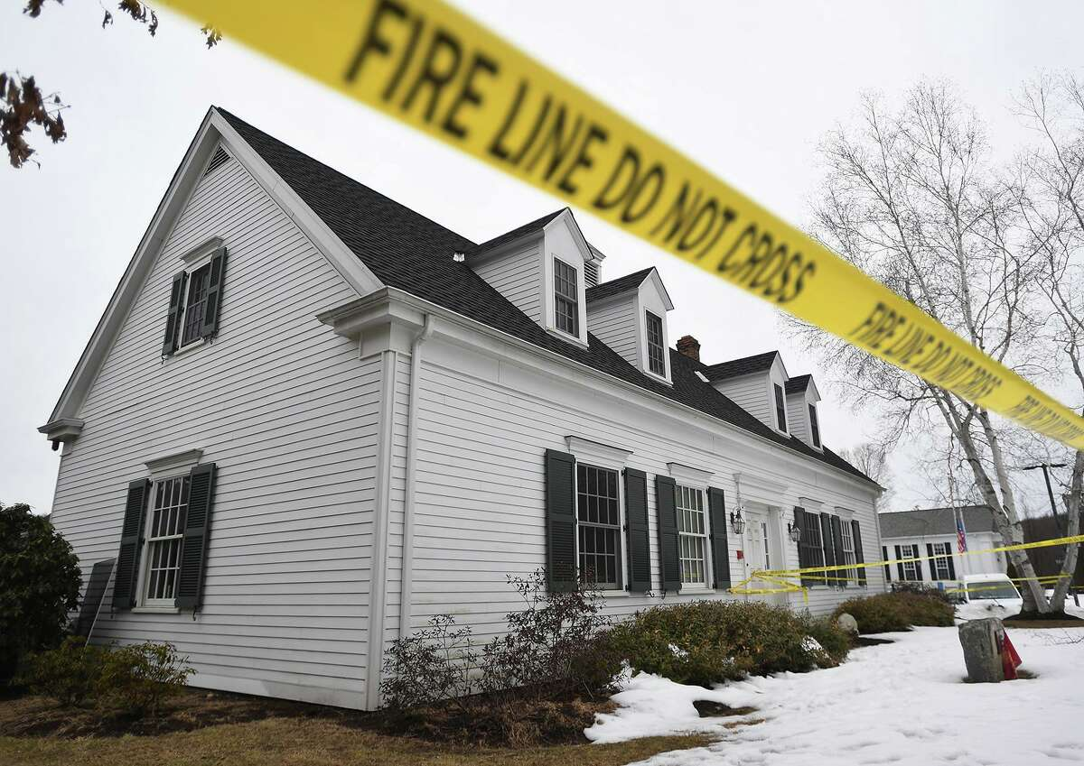 Fire line tape surrounds the Roxbury Ambulance building, site of an arson investigation at 27 North Street in Roxbury, on Sunday. Suspect Richard White, of Torrington, is currently in the custody of the Pennsylvania State Police.