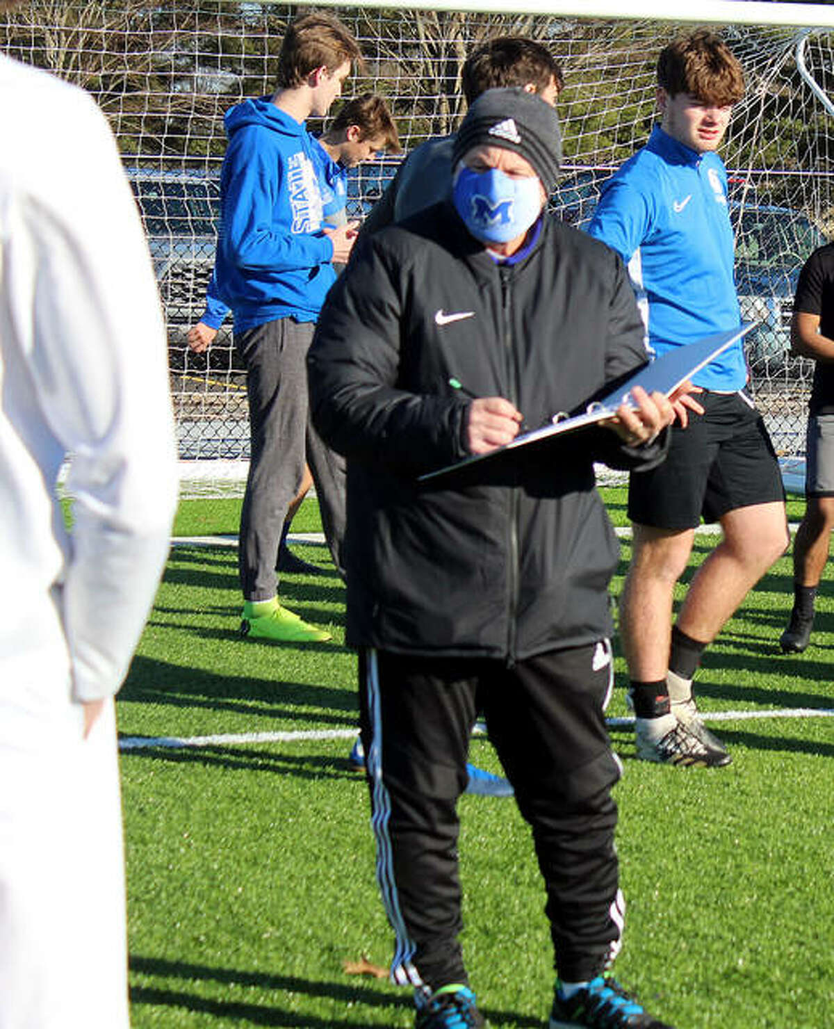 New Marquette catholic high boys soccer coach Jerry DiSalvo gathers his players for the first official preseason practice Monday at Gordon Moore Park.