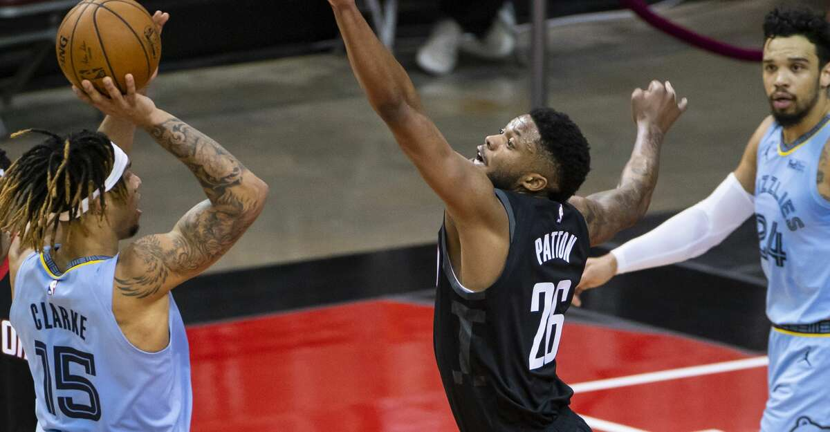 Houston Rockets center Justin Patton (26) tries to stop a shot by Memphis Grizzlies forward Brandon Clarke (15) during the first quarter of an NBA basketball game between the Houston Rockets and Memphis Grizzlies on Sunday, Feb. 28, 2021, at Toyota Center in Houston.