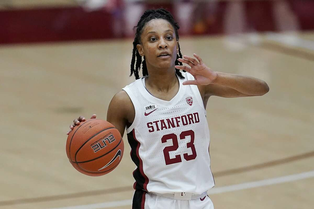 Stanford guard Kiana Williams (23) signals to teammates against California during the first half of an NCAA college basketball game in Stanford, Calif., Sunday, Feb. 28, 2021. (AP Photo/Jeff Chiu)