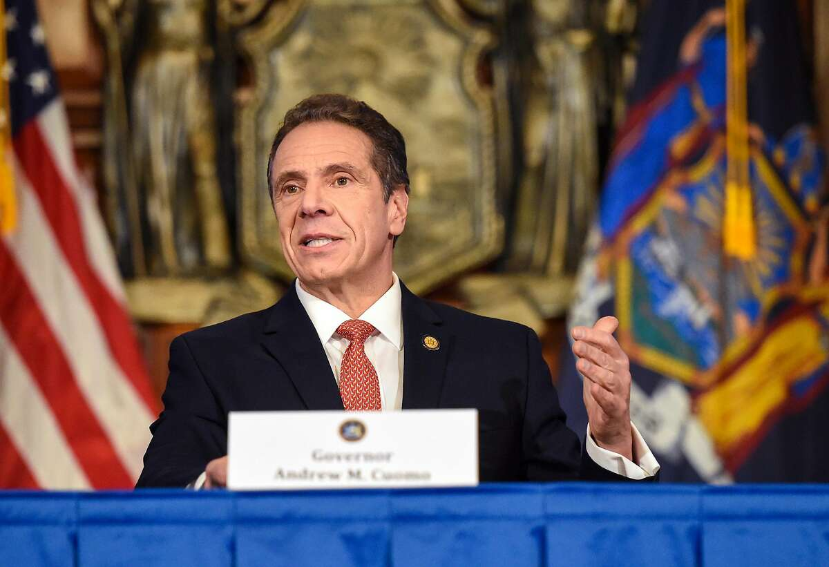 """FILE -- New York Gov. Andrew Cuomo addresses a news conference about the coronavirus, at the Capitol in Albany, N.Y., April 15, 2020. Anna Ruch said she felt """"uncomfortable and embarrassed"""" when Cuomo placed his hands on her face and asked to kiss her at a crowded New York City wedding reception in September 2019. (Cindy Schultz/The New York Times)"""