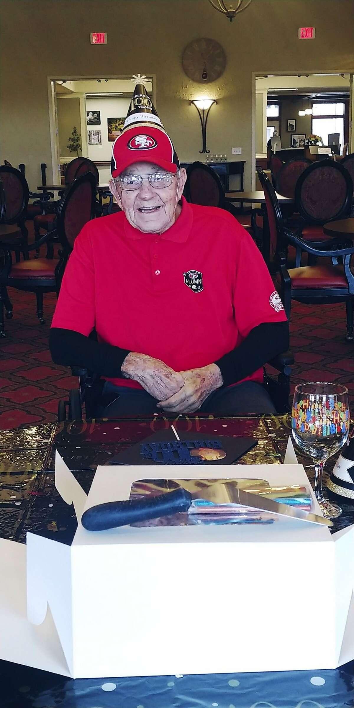Ken Casanega celebrating his 100th birthday at The Springs at Veranda Park, a senior living center in Medford, Ore.