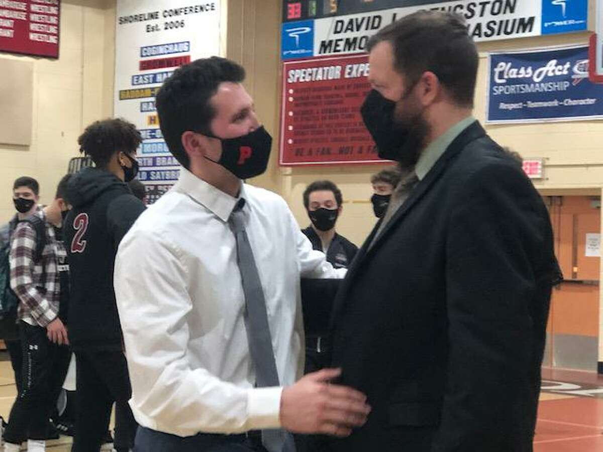 Portland coach David Bradbury Jr., left, and Valley's Kevin Woods meet at halfcourt after Woods' Warriors beat his former player's Highlanders 64-60 Monday night.