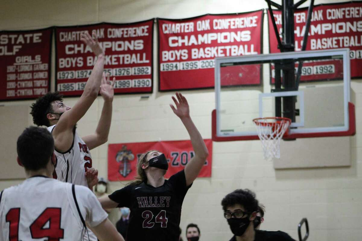 Portland's Cam Latronica shoots over Valley's James Marsden in the fourth quarter of Monday's Shoreline game in Portland.