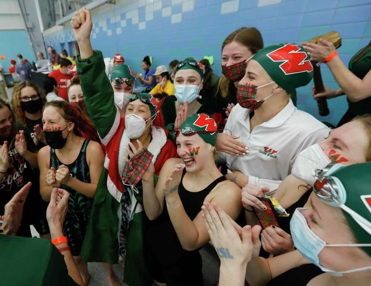 Alyssa Sorensen of The Woodlands reacts with teammate after the program won the Class 6A girls team title during the UIL State Swimming & Diving Championships, Monday, March 1, 2021, in San Antonio.