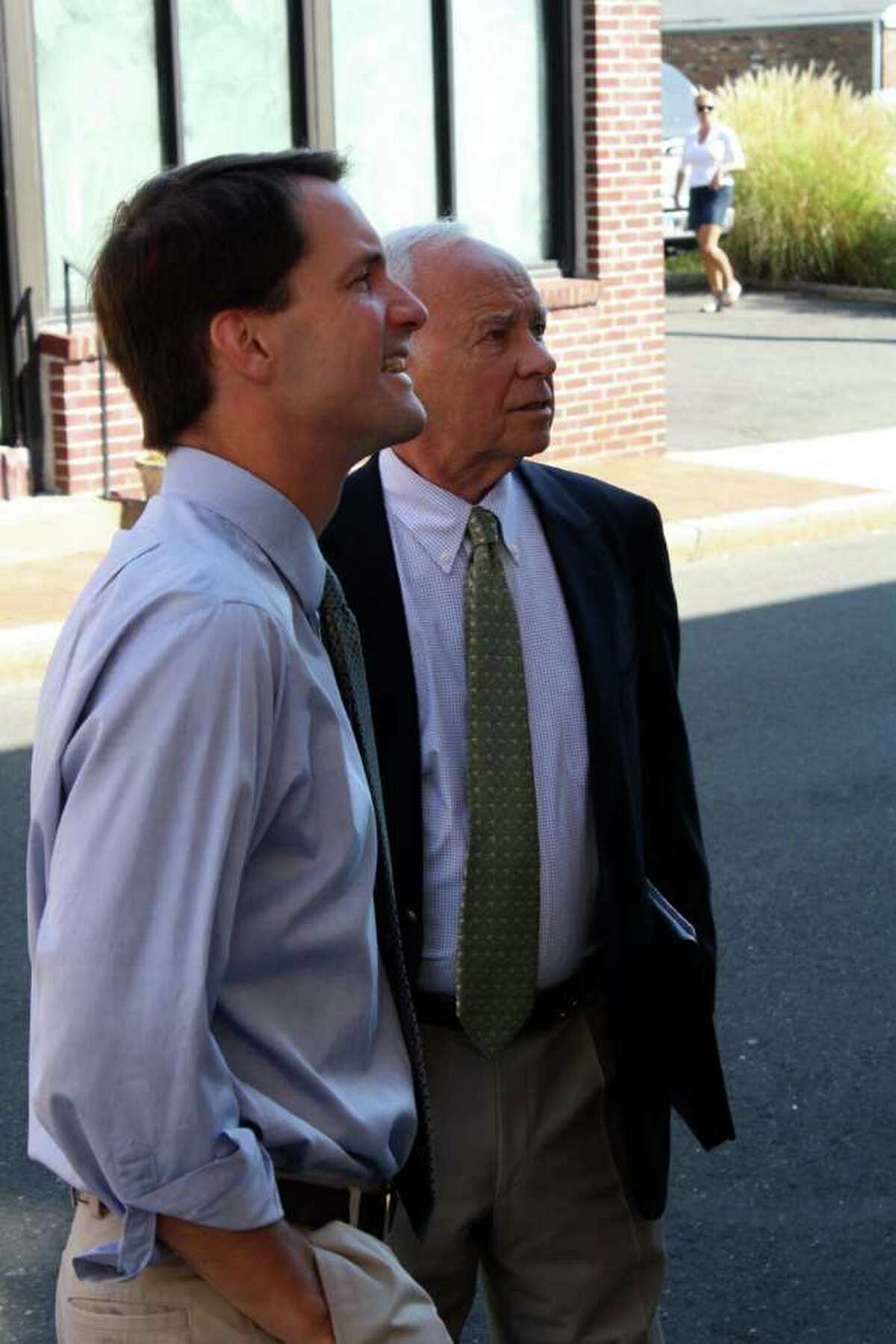 Rep. Jim Himes and First Selectman Jeb Walker toured businesses on Elm Street early Tuesday morning.