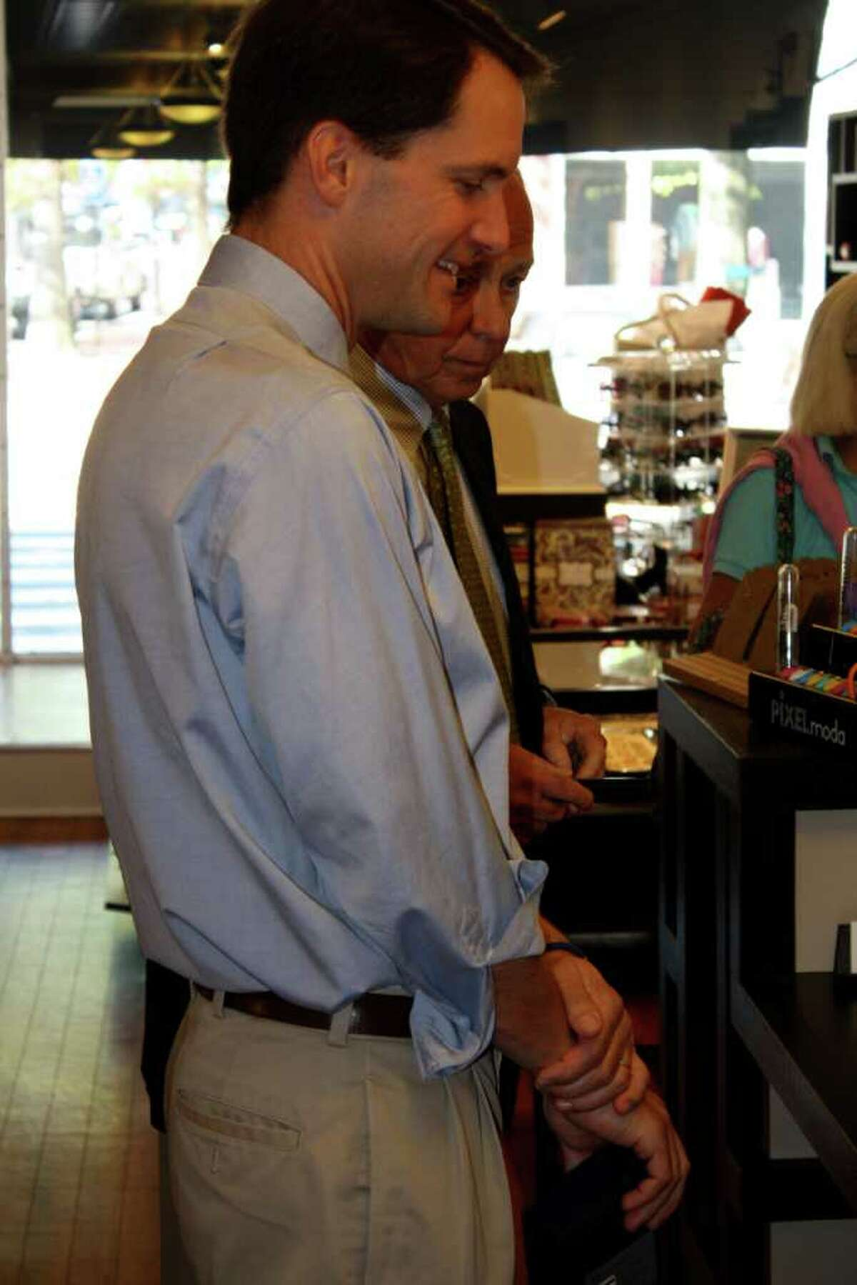 Rep. Jim Himes browses the inventory at M Milestones.