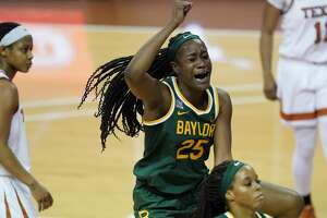 Baylor center Queen Egbo (25) celebrates a score against Texas during the second half of an NCAA college basketball game, Monday, March 1, 2021, in Austin, Texas. (AP Photo/Eric Gay)