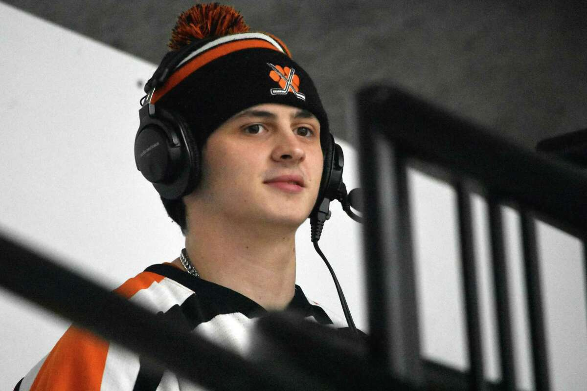 Ridgefied's Mike Conciatore calls the ice hockey game against Darien at the Winter Gardern on Feb. 24, 2021. Conciatore is a member of the Ridgefield hockey team and was going to play this season before an offseason injury forced him to miss the season. Conciatore turned to another love of his, broadcasting games.