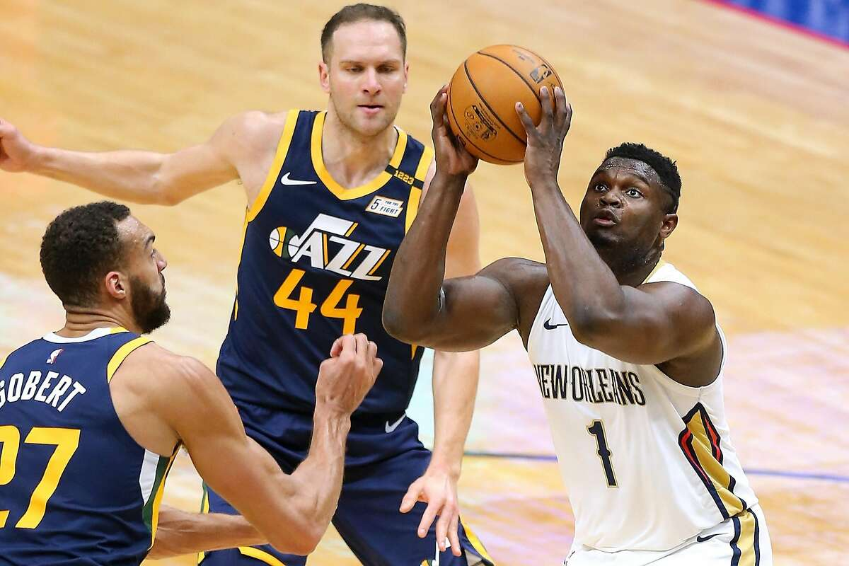 NEW ORLEANS, LOUISIANA - MARCH 01: Zion Williamson #1 of the New Orleans Pelicans looks to shoot against Rudy Gobert #27 and Bojan Bogdanovic #44 of the Utah Jazz during the first half at the Smoothie King Center on March 01, 2021 in New Orleans, Louisiana. NOTE TO USER: User expressly acknowledges and agrees that, by downloading and or using this Photograph, user is consenting to the terms and conditions of the Getty Images License Agreement. (Photo by Jonathan Bachman/Getty Images)