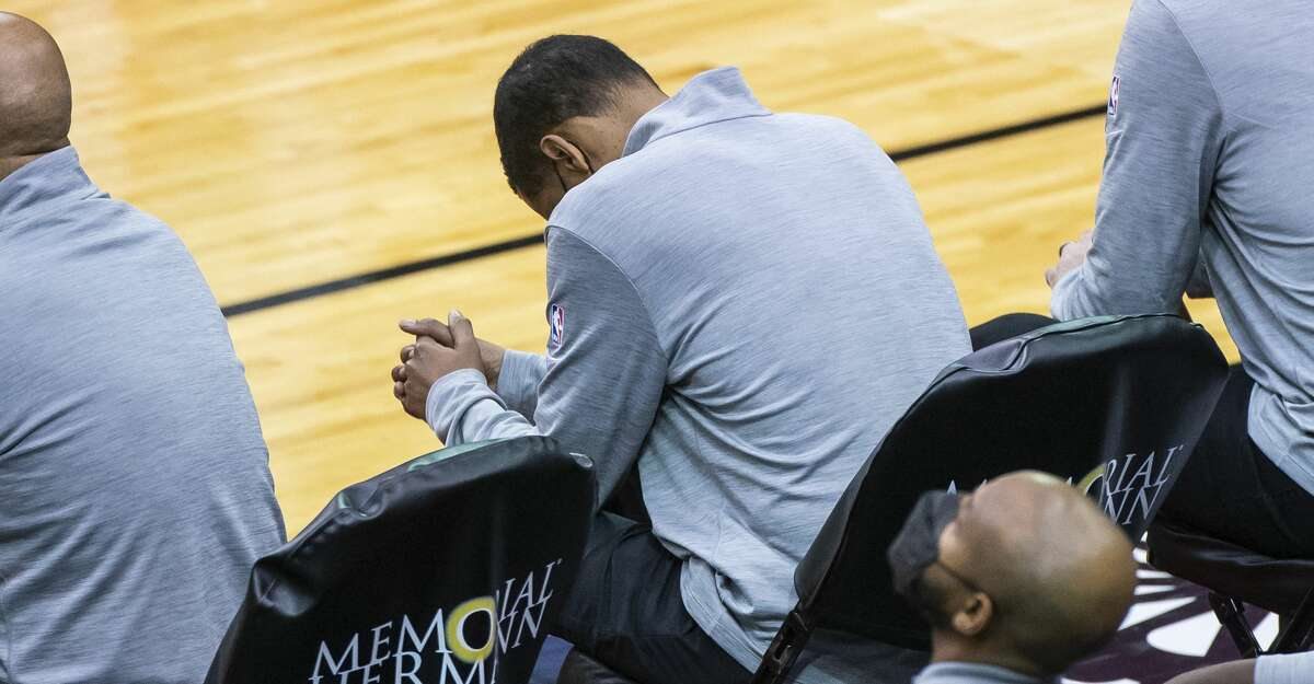 Rockets head coach Stephen Silas puts his head down on the bench during the final seconds of the fourth quarter of Monday's loss to the Cavaliers at Toyota Center.