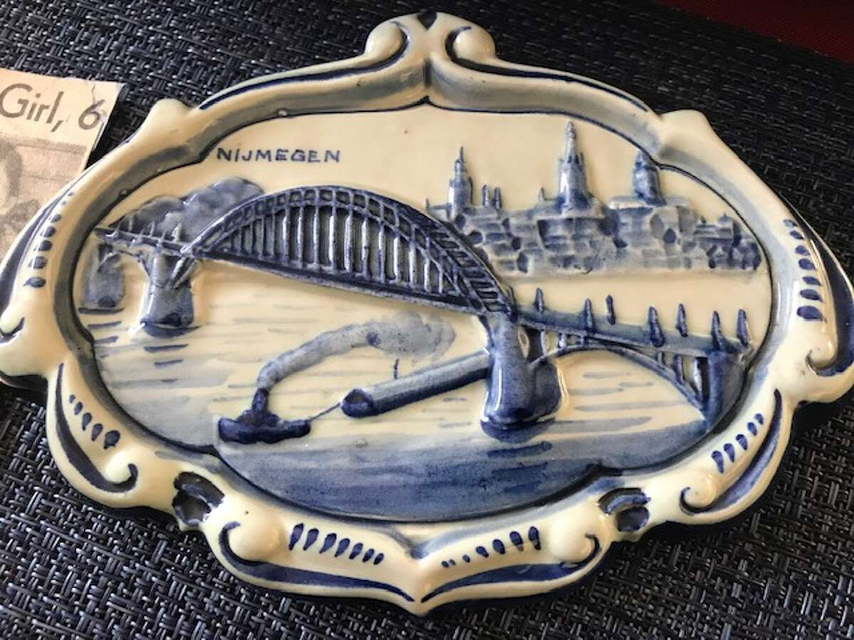This porcelain keepsake depicts the bridge over the Waal River where the U.S. 82nd Airborne Division pushed back Nazi forces and liberated the Dutch city of Nijmegen in September 1944.