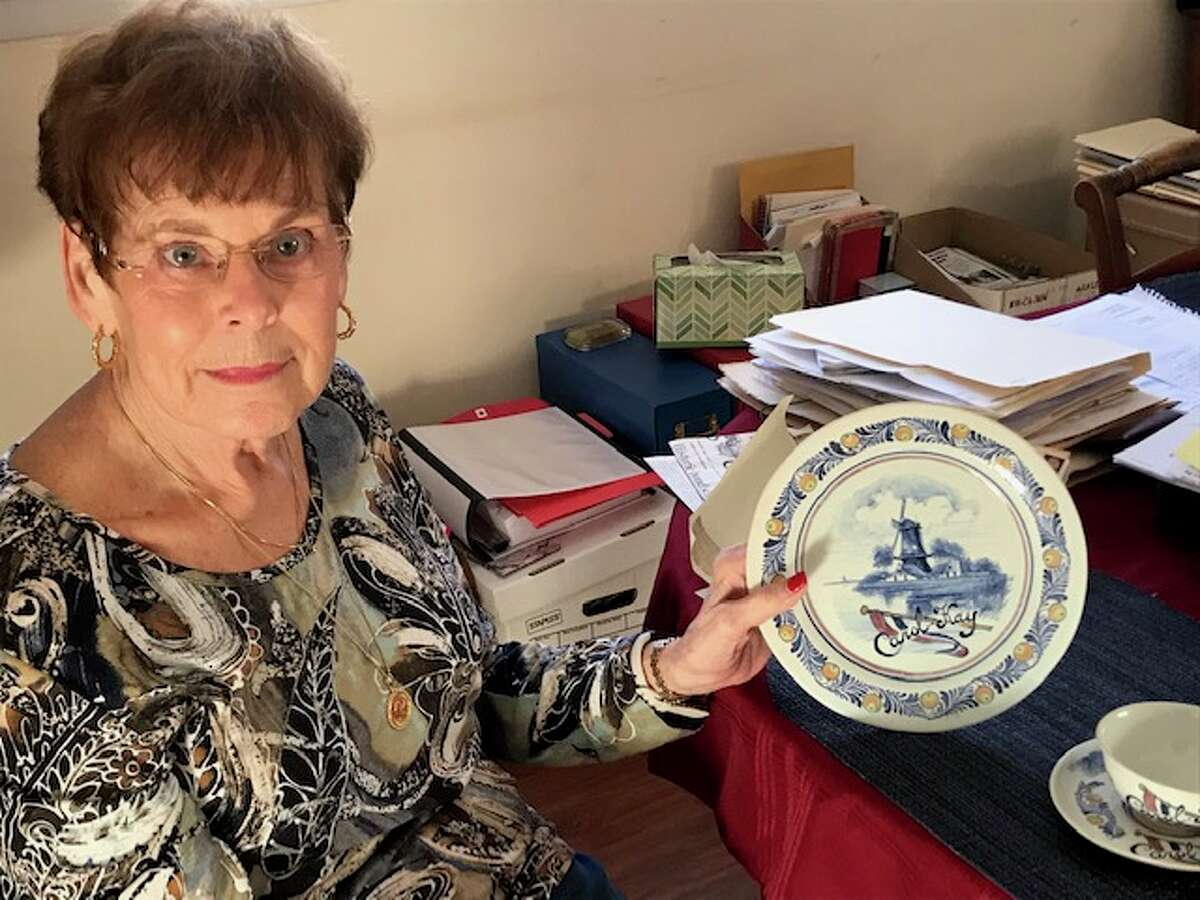 Carol Mayone holds a plate sent in 1946 to her when she was 6 as a thank-you gift from Ineke Keyser in Nijmegen.