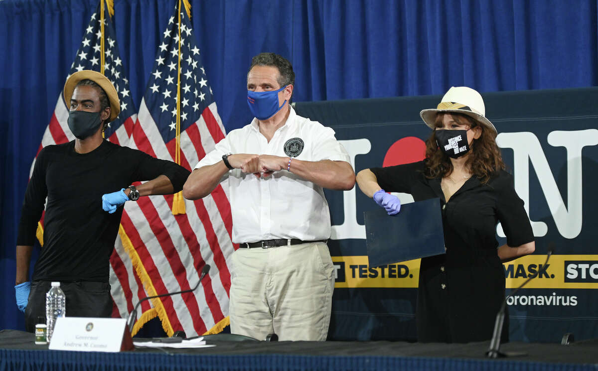 Andrew M. Cuomo at the Madison Square Boys & Girls Club in Brooklyn, where he was joined by Brooklynites Chris Rock and Rosie Perez on May 28, 2020. The actors were on hand to promote testing and the wearing of PPE while in public.