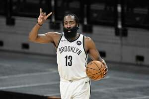 Brooklyn Nets' James Harden signals to teammates during the second half of an NBA basketball game against the San Antonio Spurs, Monday, March 1, 2021, in San Antonio. Brooklyn won 124-113. (AP Photo/Darren Abate)