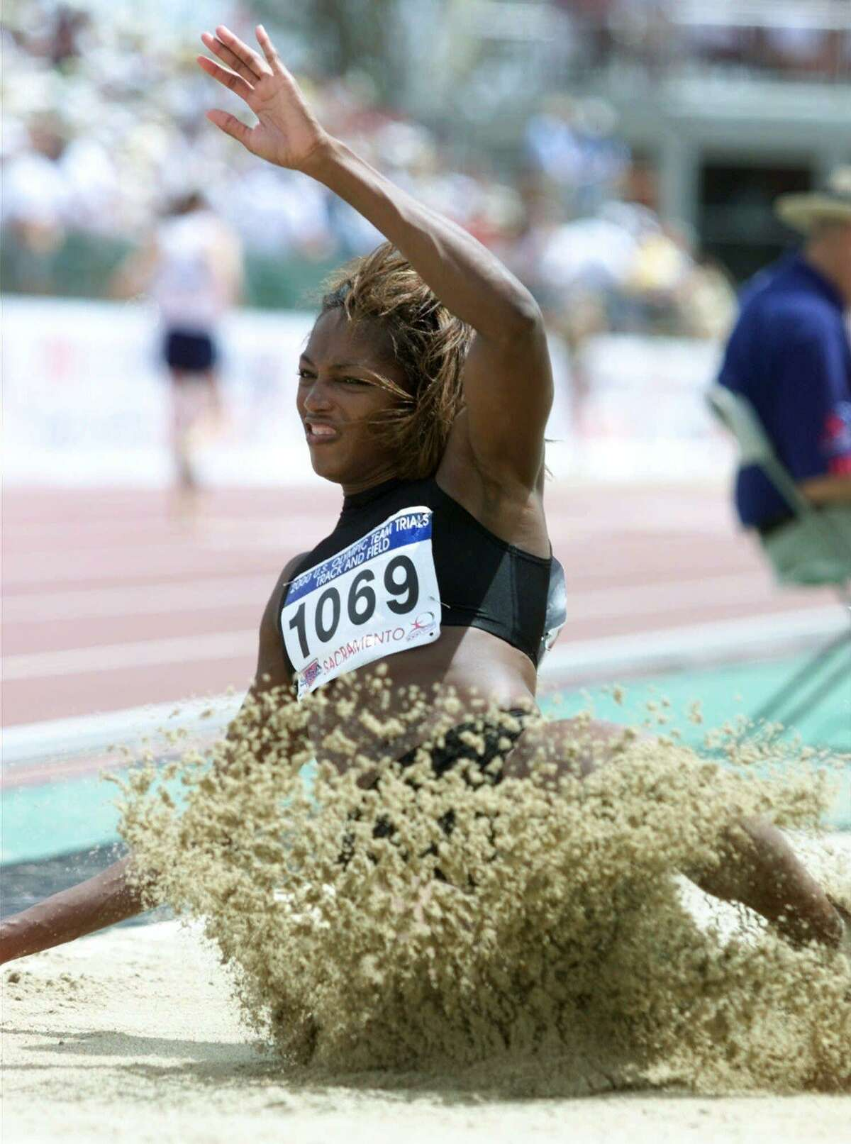 Dawn Burrell lands in the sand during the women's long jump final at the U.S. Olympic Track & Field Trials in Sacramento, Calif., Sunday, July 16, 2000. Burrell placed second in the event.