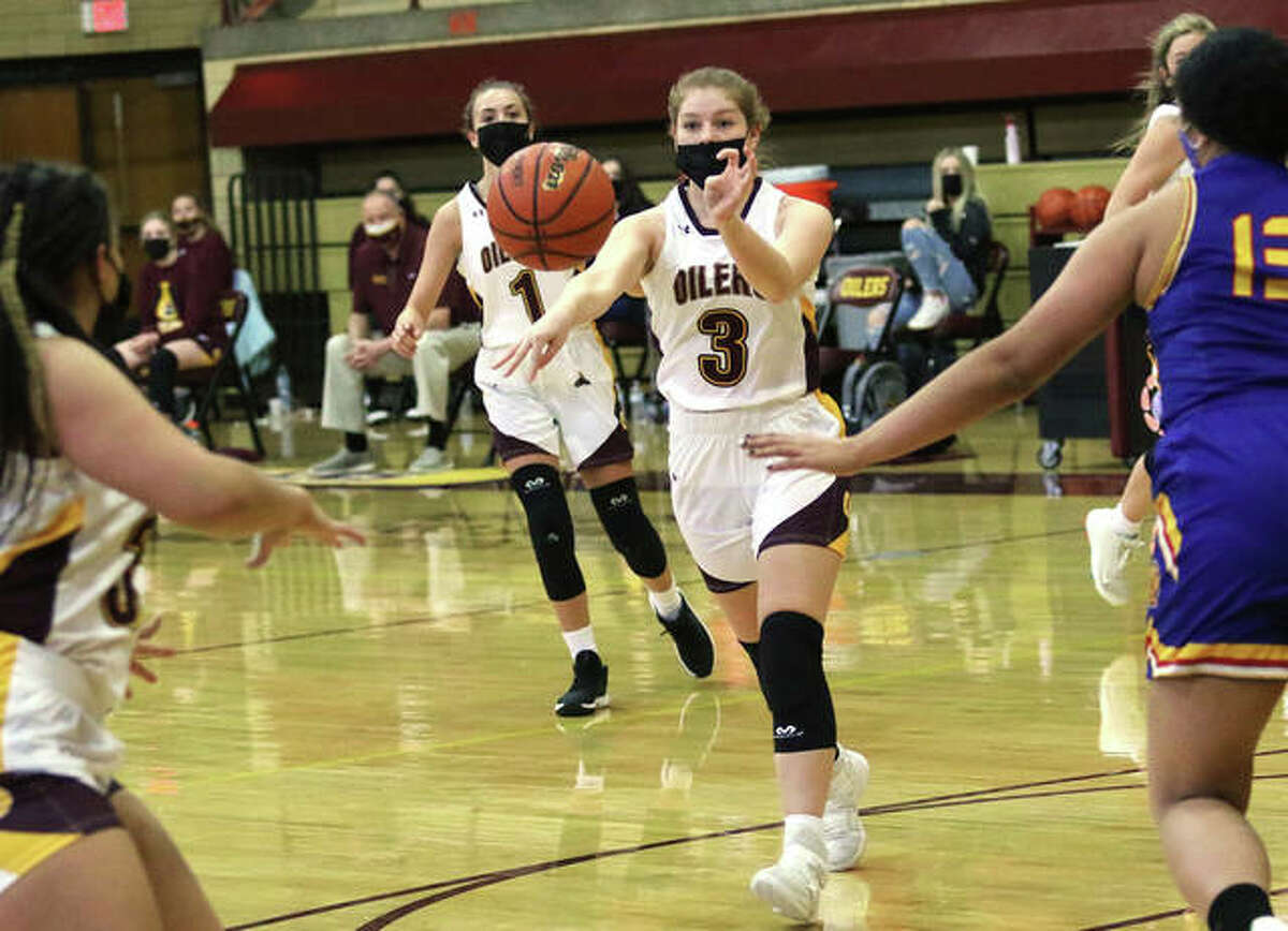 EA-WR's Karli Withers (3), shown passing to a teammate in a Feb. 6 game at Wood River, hit a deep 3-pointer at the buzzer to give the Oilers a win Monday night at Memorial Gym in Wood River.