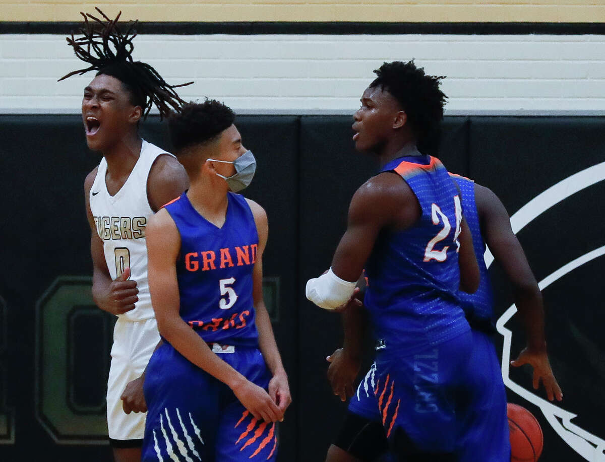 Conroe's Ja'Len Moore (0) reacts after drawing a foul during the second quarter of a District 13-6A high school basketball game at Conroe High School, Wednesday, Jan. 13, 2021, in Conroe.