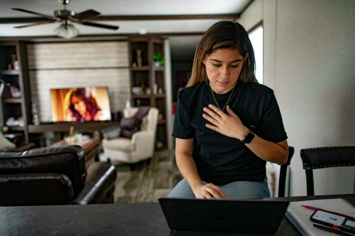 Miriam Perez, who is a DACA applicant, looks over her online lessons Wednesday for her courses at Texas A&M University-San Antonio.