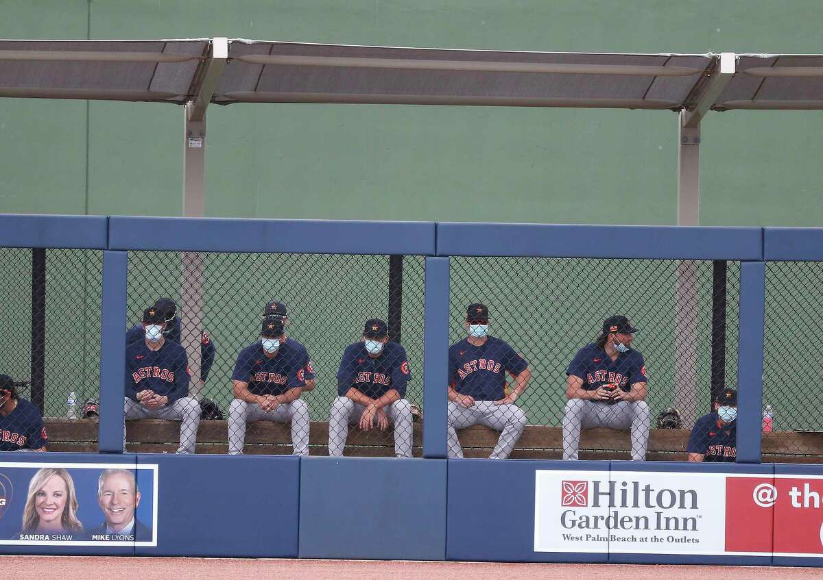 Houston Astros pitchers in the bullpen during the first inning of an MLB spring training game at Ballpark of the Palm Beaches in West Palm Beach, Florida, Monday, March 1, 2021.