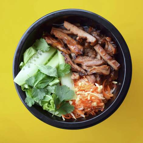 Lemongrass chicken bowl at Yelo, a new craft banh mi shop in Katy from Phat Eatery owner Alex Au-Yeung with a menu from Cuc Lam. Photo: Sabrina Miskelly