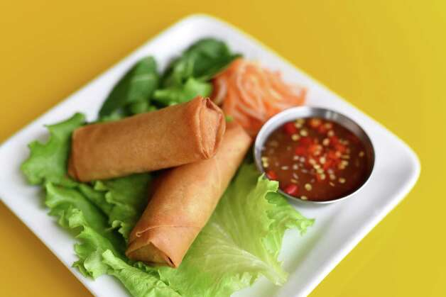 Vietnamese pork egg rolls at Yelo, a new craft banh mi shop in Katy from Phat Eatery owner Alex Au-Yeung with a menu from Cuc Lam. Photo: Kimberly Park / Kimberly Park