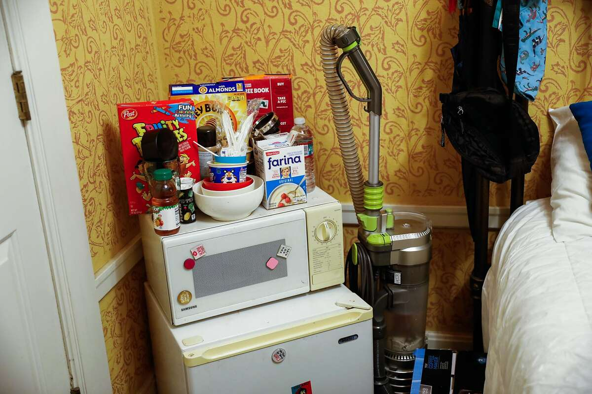 Cereal on the microwave in Chucky Torres� hotel room in the Tenderloin on Wednesday, Dec. 16, 2020 in San Francisco, California. Chucky was previously homeless and hoping to get permanent housing.