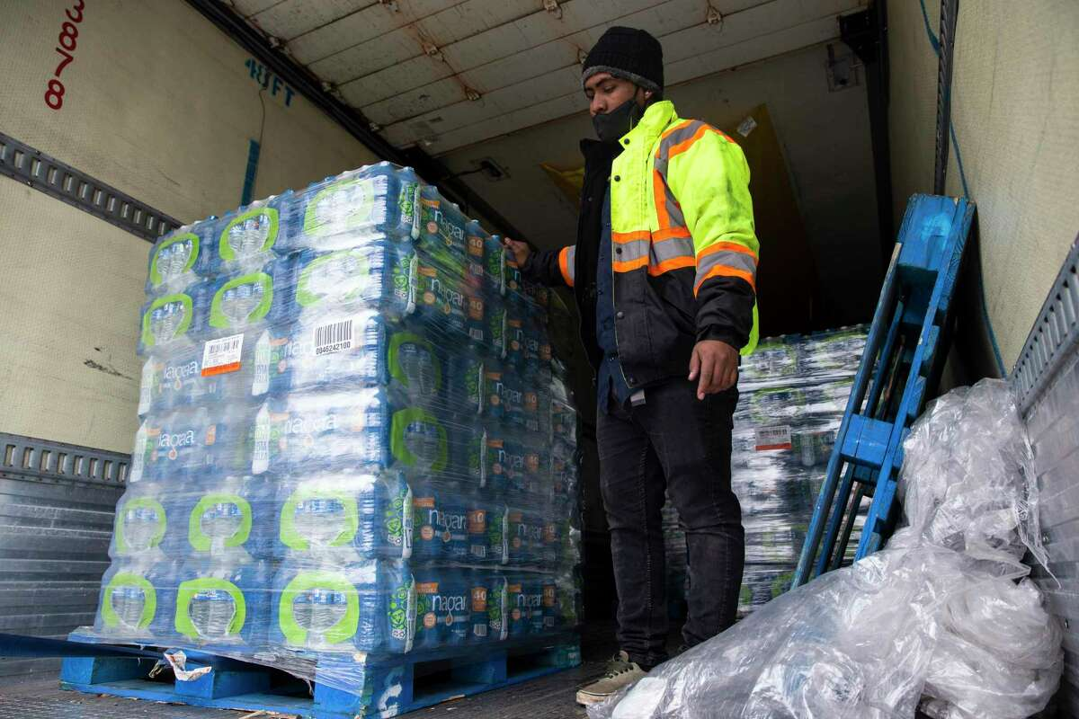 An 18-wheeler truck loaded with pallets of bottled water arrives at a water distribution site for people in need because of the boil water order and low water pressure Thursday, Feb. 18, 2021, at Emancipation Park in Houston. U.S. Rep. Sheila Jackson Lee worked with National Association of Christian Churches to get the donated water for people at several distribution sites.