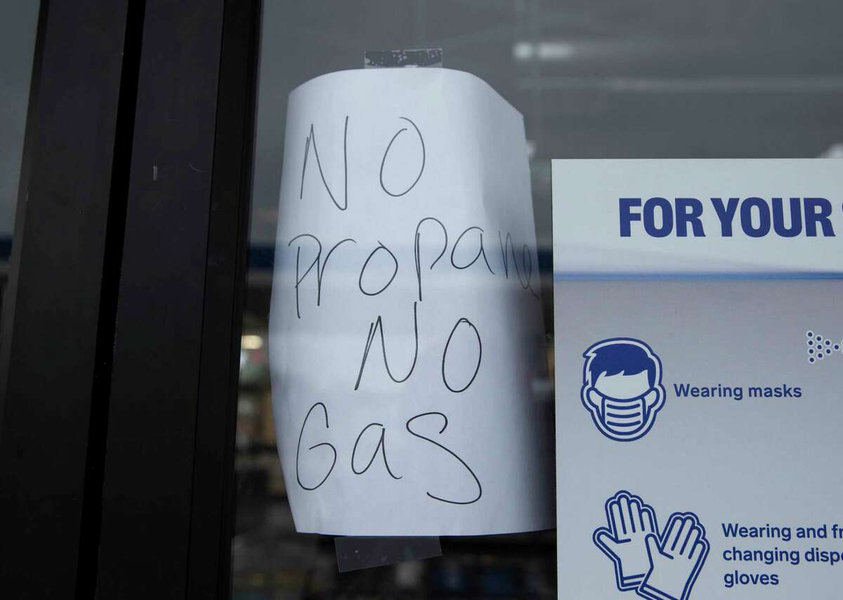 A sign at a gas station convenient store tells customers that they are out of propane and gas Thursday, Feb. 18, 2021, in Houston.