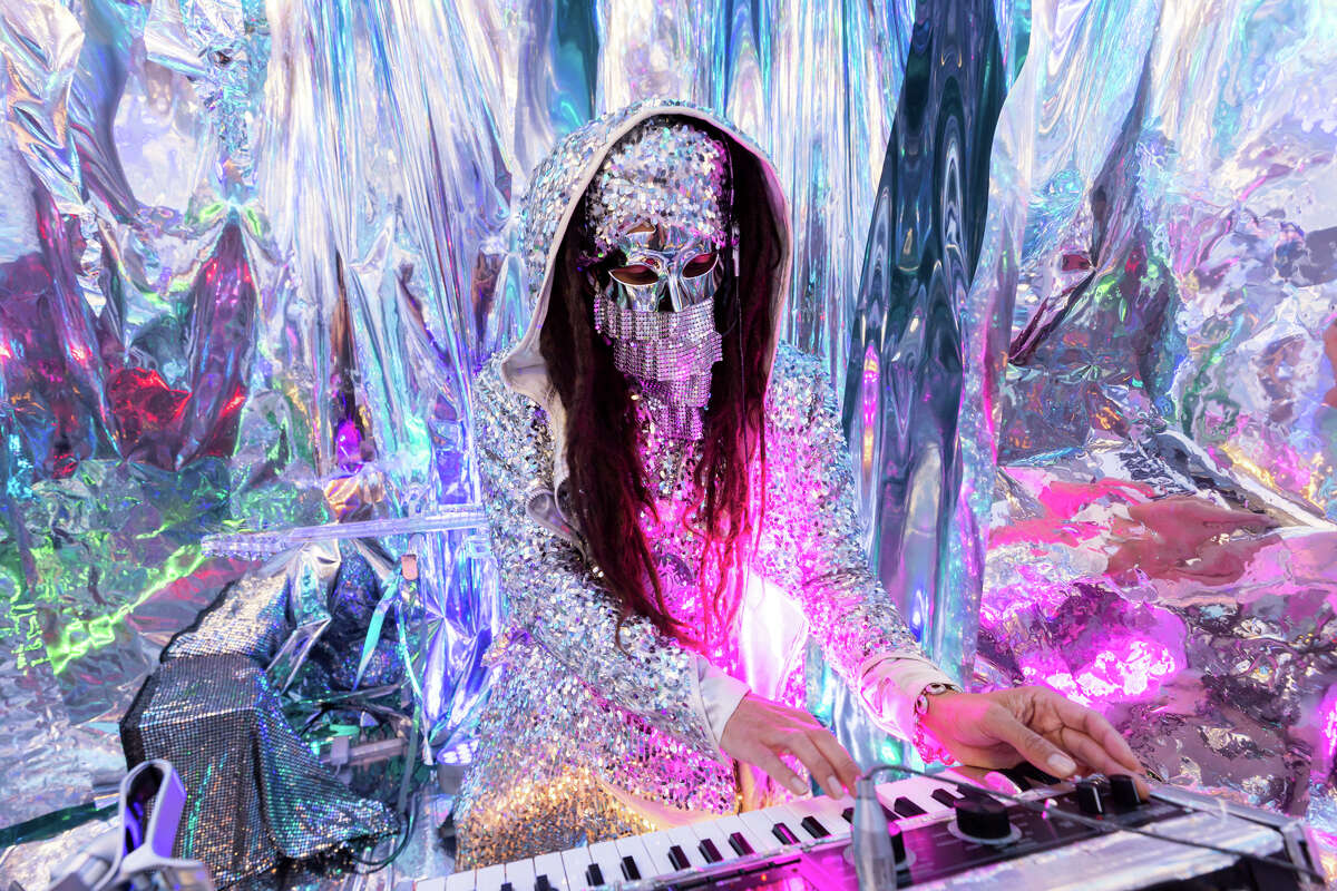 """Luis """"The Genie"""" Monterrosa plays synthesizers and guitar for his project he calls the Crystal Mirror Space Experience, which can be booked through Airbnb."""