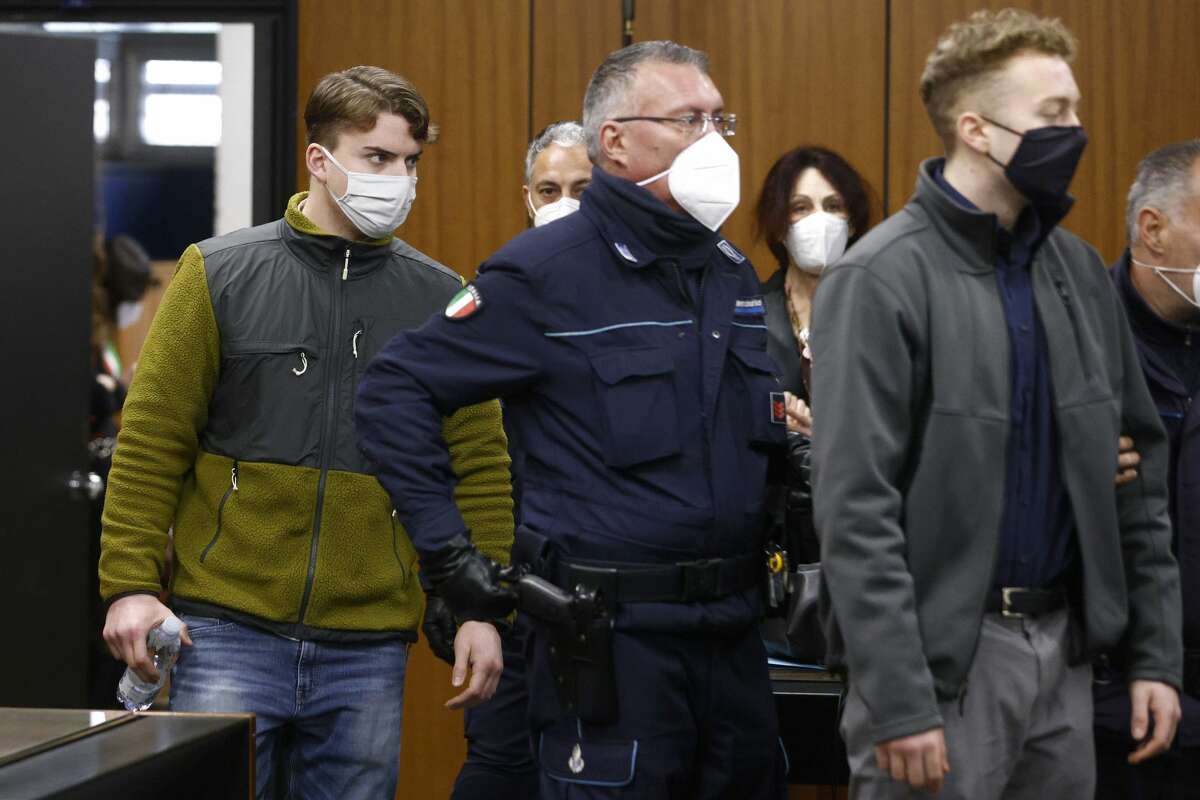 Gabriel Natale-Hjorth (L) and Finnegan Lee Elder (R), the two men accused of the killing of an Italian police officer, arrive for a hearing in their trial on February 3, 2021 in Rome. - Finnegan Lee Elder and Gabriel Natale-Hjorth are on trial over the killing of Mario Cerciello Rega, who was in plain clothes when he was slain in a night drug bust on July 26 2019.