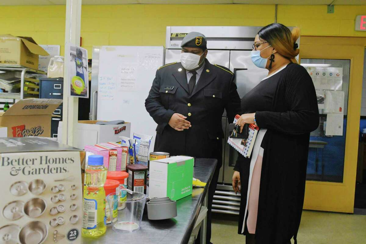 Albany High School junior Troy Millin, left, and his mother, Divonne Millin, look over some of the supplies that were given to Troy at Albany High School's Abrookin Career and Technical Center on Tuesday, March 2, 2021, in Albany, N.Y. Troy, who is a member of the Sgt. Henry Johnson Battalion, Albany High School JROTC, has been making cakes for local veterans to mark their birthdays. (Paul Buckowski/Times Union)