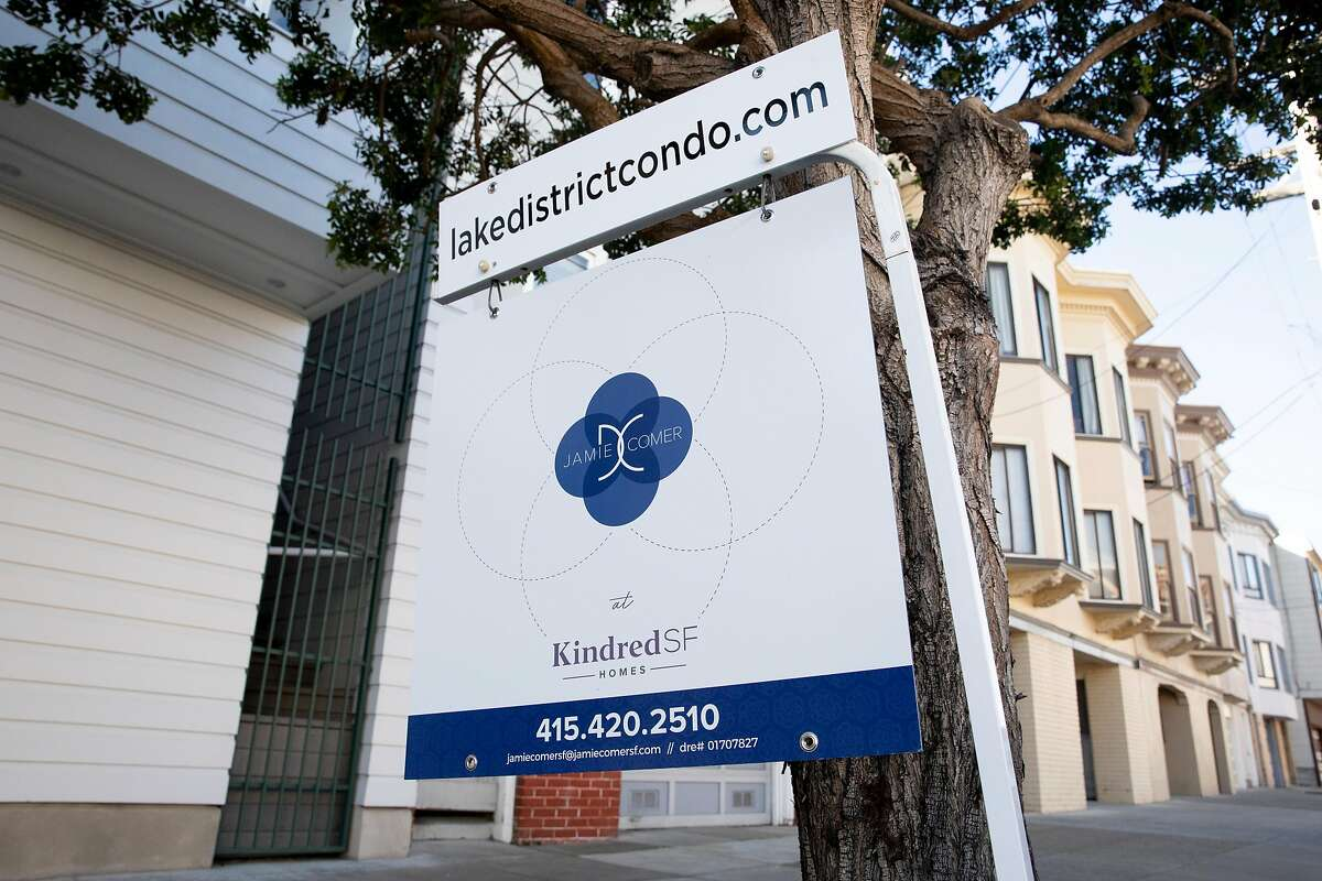 A for sale sign sits outside a listed condominium on 27th Avenue in San Francisco. The city's real estate transfer tax has been upheld by a state appeals court.