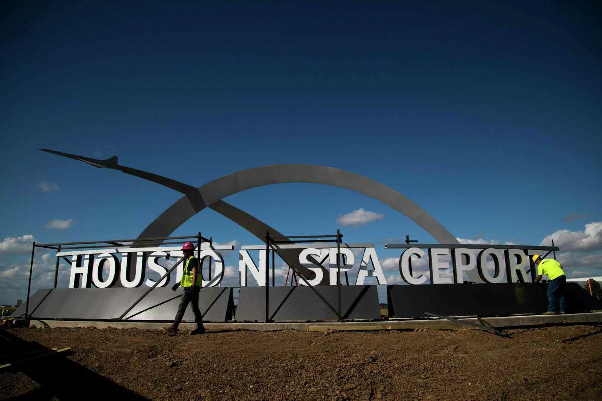 The entrance sign of the Houston Spaceport is being installed by workers, Thursday, Nov. 5, 2020, in Houston.