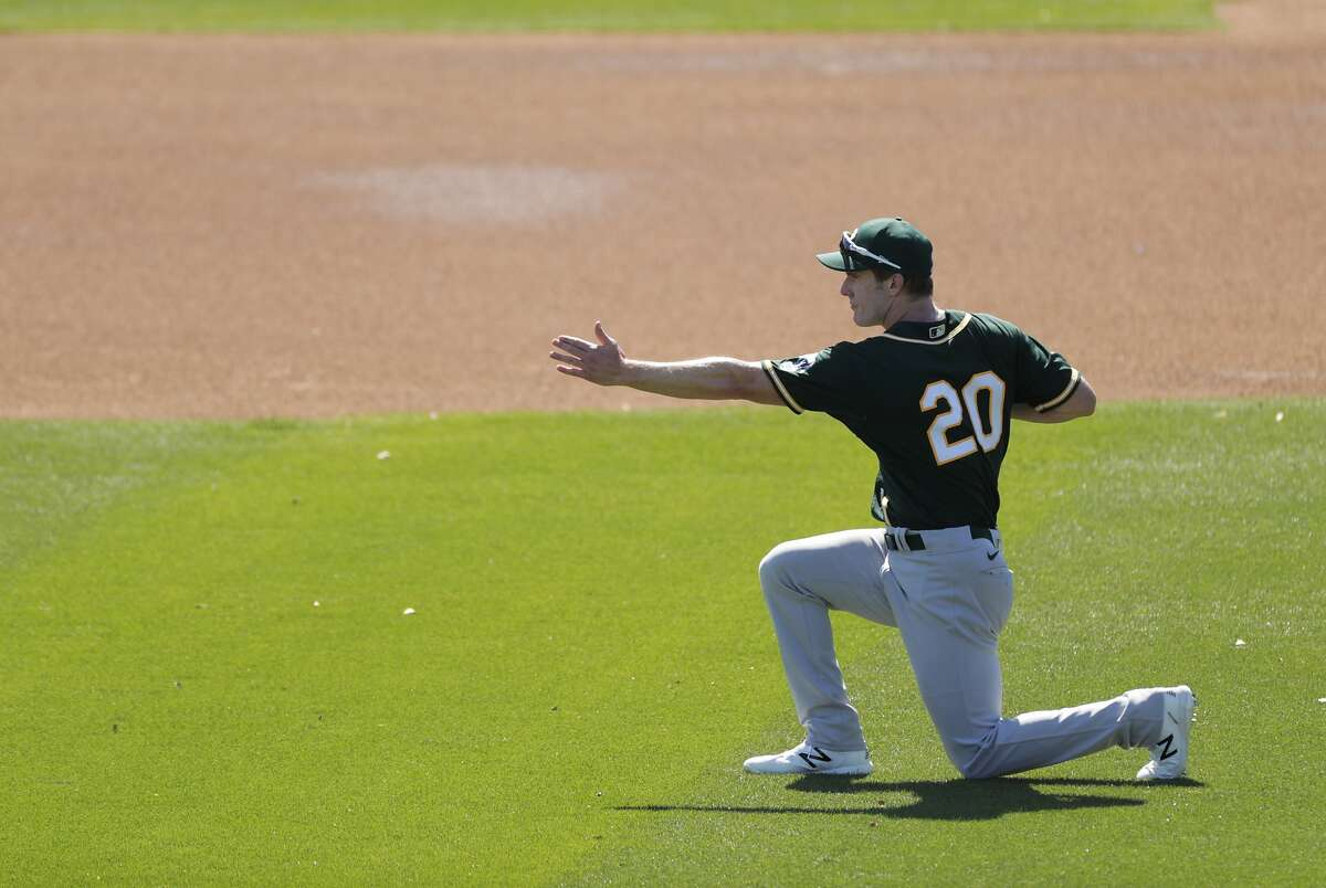 Mark Canha warms up before Tuesday's game between the Oakland Athletics and Milwaukee Brewers at American Family Fields in Phoenix, Ariz.